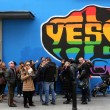 Members of the public beside a mural in Dublin's Temple Bar area by street artist SUMS supporting a yes vote in the forthcoming Gay Marriage referendum in Ireland.