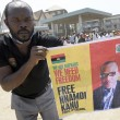 A pro-Biafra supporter holds a poster of jailed activist Nnamdi Kanu during a protest calling for his release in Aba, southeastern Nigeria, on November 18, 2015. The protesters support the creation of a breakaway state of Biafra in the southeast and want the release of Nnamdi Kanu, who is believed to be a major sponsor of the Indigenous People of Biafra (IPOB) and director of the pirate radio station Radio Biafra. AFP PHOTO / PIUS UTOMI EKPEI        (Photo credit should read PIUS UTOMI EKPEI/AFP/Getty Images)