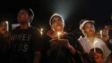 Bangladeshis light candles and sing songs as they pay tribute to those killed in the attack at the Holey Artisan Bakery in Dhaka, Bangladesh, Sunday, July 3, 2016. The assault on the restaurant in Dhaka's diplomatic zone by militants who took dozens of people hostage marks an escalation in militant violence in the Muslim-majority nation. (ANSA/AP Photo) [CopyrightNotice: Copyright 2016 The Associated Press. All rights reserved. This material may not be published, broadcast, rewritten or redistribu]